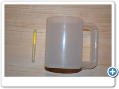 LITE DRINK MUG....lights up and makes any beer a light beer.